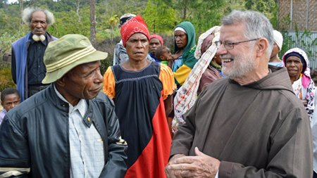 Capuchin friar laughing with a Papua New Guinea man